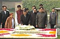 The Prime Minister of the Kingdom of Cambodia, Mr. Samdech Hun Sen laying wreath at the Samadhi of Mahatma Gandhi at Rajghat, in Delhi on December 08, 2007.jpg
