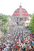 chariot festival with people drawing a chariot with ropes