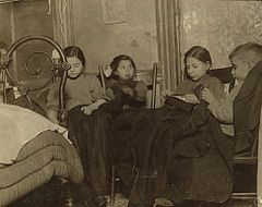 Three girls and a boy working on garments.jpg