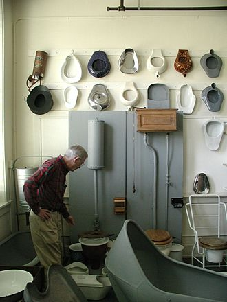 Commode - Museum collection of toilets, bed pans, hip baths, etc. The modern toilet commode is on the right.