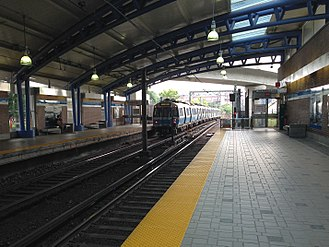 Airport (MBTA station) - An outbound Blue line train at Airport Station in 2014