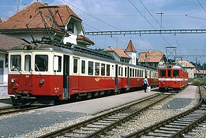 Left BDe 4/4 I 603 in dark red / cream, right BDe 4/4 I 604 in red with white stripes.  Le Noirmont, 1977