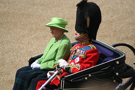 The Colonel-in-chief (Elizabeth II) alongside the then-Colonel of the Regiment (Prince Philip) in 2007. Trooping the Colour Queen Duke of Edinburgh 16th June 2007.jpg