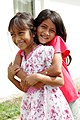 Two joyful Acehnese girls at a USAID-funded house; USAID Indonesia; March 2008.jpg