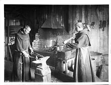 Two monks working in the blacksmith shop at Mission Santa Barbara, ca.1900 (CHS-4186).jpg