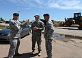 U.S. Air Force Tech. Sgt. Ben Kirkpatrick, left, with the 138th Fighter Wing security force, discusses tornado damage with Army Capt. David Jordan, center, a chaplain with Alpha Company, 1st Battalion, 279th 130522-Z-TK779-030.jpg