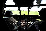 U.S. Army 1st Lt. Blake Halbert and Chief Warrant Officer 3 Mitchell Higgins, both CH-47 Chinook helicopter pilots with Bravo Company, 5th Battalion, 159th Aviation Regiment, prepare a CH-47 for takeoff at Camp 130813-F-QA406-444.jpg