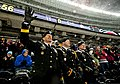 U.S. Army Maj. Gen. David J. Conboy, left, the commander of the 416th Theater Engineer Command, waves to the crowd while being introduced to the crowd alongside Capt. Curtis Miller and Sgt. John Pudowski, right 140301-A-TI382-725.jpg