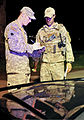 U.S. Army Sgt. Mark Newcomb, left, assigned to Alpha Company, 1st Battalion, 179th Infantry Regiment, Oklahoma Army National Guard, and U.S. Air Force Tech. Sgt. Larry Mansell exchange information at one of 130522-F-YU985-019.jpg