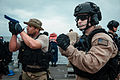 U.S. Coast Guard Maritime Enforcement Specialist 3rd Class Shaun Cooper, right, assigned to Advanced Interdiction Team 2, and Navy Fire Controlman 2nd Class Jeramie Schmadten, a member of a visit, board, search 130426-N-HN991-096.jpg
