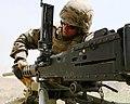 U.S. Marine Corps Lance Cpl. Chris Brigham, a machine gunner with Machine Gun Platoon, Support Company, Anti-Terrorism Battalion, 4th Marine Division, changes the barrel of an M2 .50 caliber machine gun July 25 110725-M-OS573-002.jpg