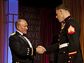 U.S. Marine Corps Sgt. Andrew C. Seif, right, shakes hands with Army Gen. Martin E. Dempsey, the chairman of the Joint Chiefs of Staff, before receiving the USO Marine of the Year award during the 2013 USO gala 131025-M-KS211-018.jpg