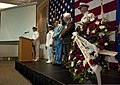 U.S. Navy Chief Culinary Specialist Eric Russell, left, the master of ceremonies for an event commemorating the Battle of Midway and Memorial Day, speaks at Naval Station Everett, Wash., June 7, 2013 130607-N-MM360-045.jpg