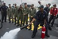 U.S. Navy Damage Controlman 2nd Class Endulk Hailu, right, demonstrates firefighting procedures to Philippine sailors during a crash and salvage drill aboard the guided missile destroyer USS John S. McCain (DDG 140627-N-UN259-314.jpg