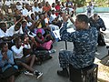 U.S. Navy Musician 2nd Class Kori Gillis, and Musician 1st Class Robert Collier, right, both with Flagship, a Commander, Naval Forces Europe-Africa Band ensemble, perform for students at Instituto Agrario de 120612-N-GA722-059.jpg