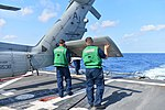 U.S. Sailors extend the tail of an MH-60R Seahawk helicopter attached to Helicopter Maritime Strike Squadron (HSM) 70 on the flight deck of the guided missile destroyer USS Truxtun (DDG 103) in the Atlantic 130807-N-YZ751-043.jpg