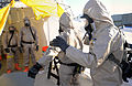 U.S. Service members with the Chemical, Biological, Radiological, Nuclear and High-Yield Explosive Enhanced Response Force Package, Oregon National Guard begin a decontamination process March 30, 2014, during 140330-Z-CH590-992.jpg