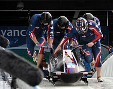 Sled starting run during a sports event.