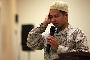 Salah - A muezzin calling the adhan.
