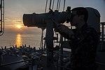 USS George Washington sailor uses binoculars 131026-N-IP531-036.jpg