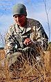 US Army paratrooper recovers parachute 141211-A-QW291-131.jpg