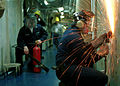 US Navy 020412-N-9421C-001 Sailor grinds.jpg