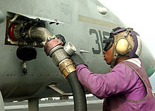 US Navy 020920-N-1082Z-001 Airman Connie Coats from New Orleans, La., fuels an F-A-18.jpg