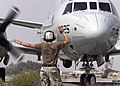 US Navy 030411-N-8921O-003 Aviation Structural Mechanic Airman Frank Wendt signals a right turn for a P-3C Orion.jpg