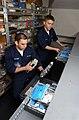 US Navy 030415-N-4953E-063 Airman Jason Langa and Airman Radames Martinez perform inventories on surface depot level repairable parts in the Repairable Asset Management Shop aboard USS Harry S. Truman (CVN 75).jpg