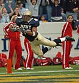 US Navy 041120-N-9693M-010 U.S. Naval Academy Midshipman 3rd Class David Mahoney leaps across the goal line to score the third Navy touchdown against Rutgers University in the 1st quarter of play.jpg