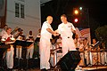 US Navy 050220-N-2468S-005 Seventh Fleet Band Master Lt.j.g Carl Gerhard, right, congratulates Musician 2nd Class Thomas Horner and the rest of the Seventh Fleet band during a free public concert held in Colombo, Sri Lanka.jpg