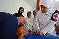 US Navy 050301-N-8629M-357 Chief Hospital Corpsman James Price, left, instructs an Indonesian nurse on the proper application of cardio pulmonary resuscitation.jpg