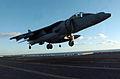 US Navy 051203-N-9866B-141 An AV-8B Harrier prepares to land on the flight deck of the amphibious assault ship USS Peleliu (LHA 5).jpg