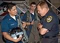 US Navy 061018-N-7478G-030 Aircrew Survival Equipmentman 2nd Class Jess E. Chacon and Aircrew Survival Equipmentman Airman Nathan Ulbrich both assigned to the Bounty Hunters of Strike Fighter Squadron Two (VFA-2) explains the u.jpg