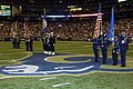 US Navy 061105-F-9032T-017 Members of the Armed Forces color guard perform during a Veteran's Day ceremony Held at the Edwards Jones Dome.jpg