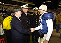 US Navy 061202-N-0696M-136 Secretary of the Navy, Dr. Donald C. Winter, congratulates Naval Academy Midshipmen quarterback Kaipo-Noa Kaheaku-Enhada (10), from Kapolei, Hawaii, after leading his team to a 26-14 win over Army.jpg