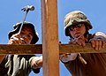 US Navy 070220-N-6901L-198 Builder 2nd Class Chad Smith, right, assigned to Naval Mobile Construction Battalion Three and Pfc. Marlon Seytes, a Philippine Marine from the 5th Marines, work together to build a new school.jpg