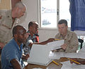 US Navy 070328-N-1003P-002 Master Chief Engineman Shannon Thornton and Electrician's Mate 1st Class Brent Arntzen assigned to Combined Joint Task Force-Horn of Africa's Mobile Training Team teach members of the Djiboutian Navy.jpg