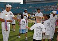 US Navy 070428-N-1522S-030 Naval Station Mayport Sailors pass out medals to children participating in the Let Us Play 2k Run at the Jacksonville Municipal Stadium.jpg