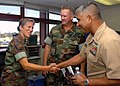 US Navy 070917-N-0775Y-014 Master Chief Petty Officer of the Navy (MCPON) Joe R. Campa Jr. shakes hands with Personnel Specialist 1st Class Erika Johnson during his tour of Naval Mobile Construction Battalion (NMCB) 3.jpg