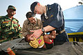 US Navy 071128-M-7696M-104 Lt. Cmdr. Trey Hollis, chief surgeon of the 22nd Marine Expeditionary Unit (MEU) (Special Operations Capable) Command Element, works alongside Lt. Cmdr. Lou C. Cimorelli, a family practice physician.jpg