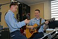 US Navy 080207-N-8102J-001 Musician 3rd Class Michael Buenvenida and Musician 3rd Class Gene Register, guitarist for the rock band.jpg