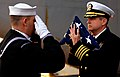 US Navy 081108-N-6854D-010 Capt. Dee L. Mewbourne receives the Ensign during a burial at sea.jpg