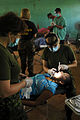 US Navy 081119-N-8907D-022 Military dentists and dental technicians embarked aboard the amphibious assault ship USS Kearsarge (LHD 3) perform dental procedures during medical operations at the Port Kaituma Skills Training Centr.jpg