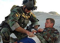 US Navy 081210-N-5366K-073 A Special Warfare Combatant-craft Crewman treats an injured teammate during a casualty assistance and evacuation scenario.jpg