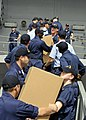 US Navy 090219-N-7280V-044 Sailors unload pallets of medicine, books, and toys to be donated.jpg