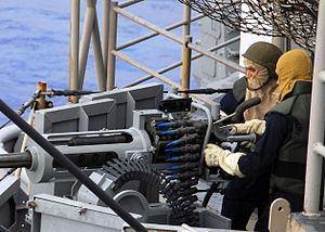 Crew-served weapon - Sailors prepare a 25 mm crew-served weapon before a live-fire exercise aboard the amphibious assault ship USS Essex.