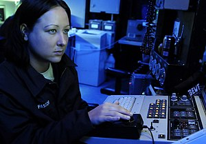 US Navy 091019-N-7478G-090 Cryptologic Technician (Technical) Seaman Jennifer Pastor stands watch at the Surface Electronics Emission Console (SLQ-32) in the combat information center aboard the amphibious command ship USS Blue