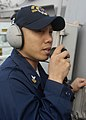 US Navy 091111-N-9520G-042 Yeoman 1st Class Kenneth Vinoya relays messages to the bridge as USS Mustin (DDG 89) approaches USNS Rappahannock (T-AO 204).jpg