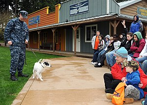 US Navy 100401-N-4649C-004 Children participating in a Kids' Day Deployment meet Zorro, a military working dog and his handler, Master-At-Arms 1st Class Josh Vanorden, from Naval Base Kitsap Security